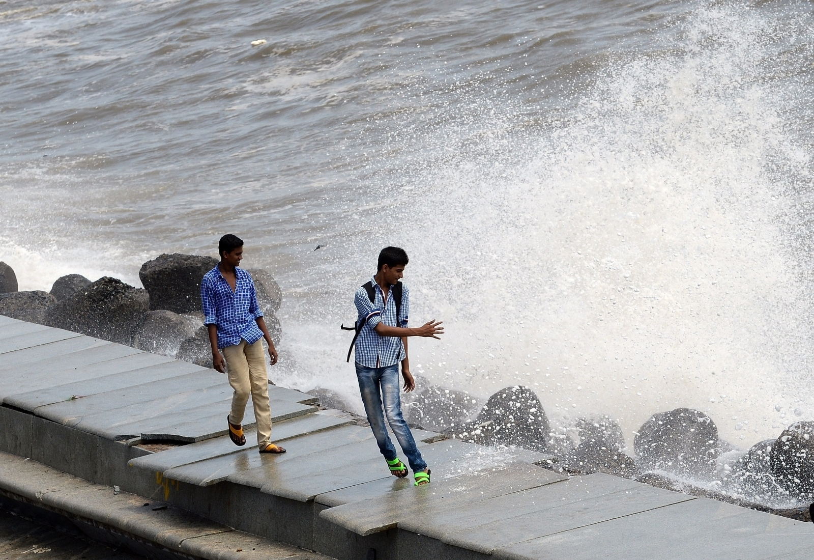 Young men by the ocean in Mumbai