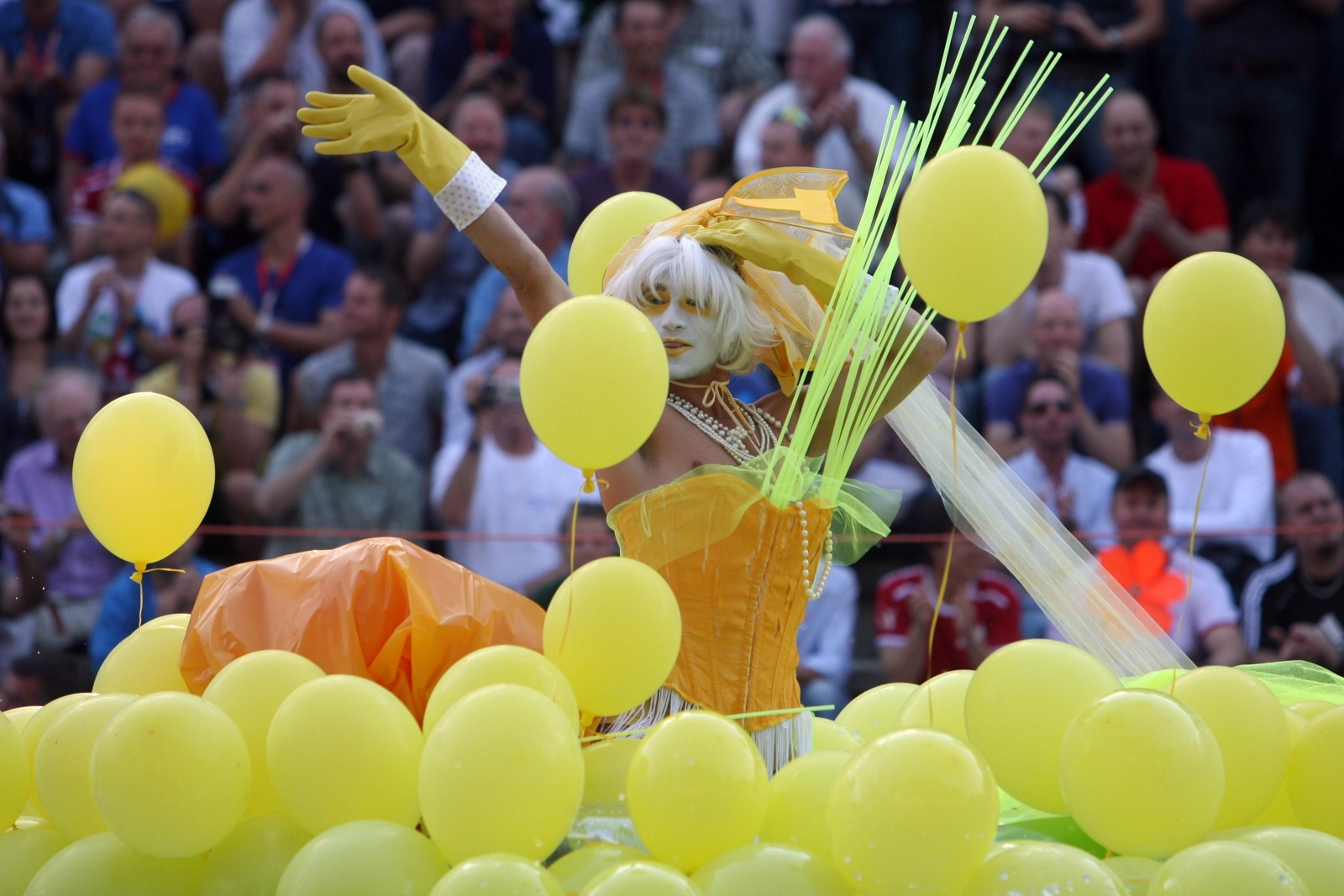 A man performs in the freestyle competition of the waterballet event on the pink friday party of the Gay Games in Cologne 2010