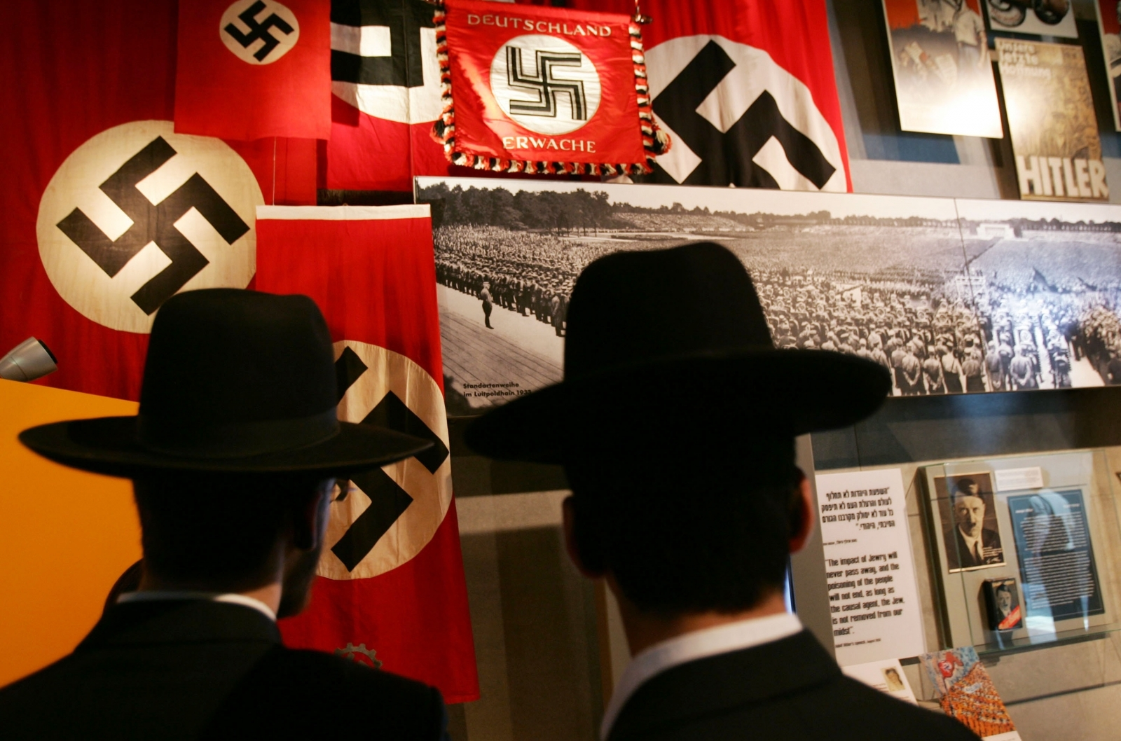 Jews in front of Swastikas