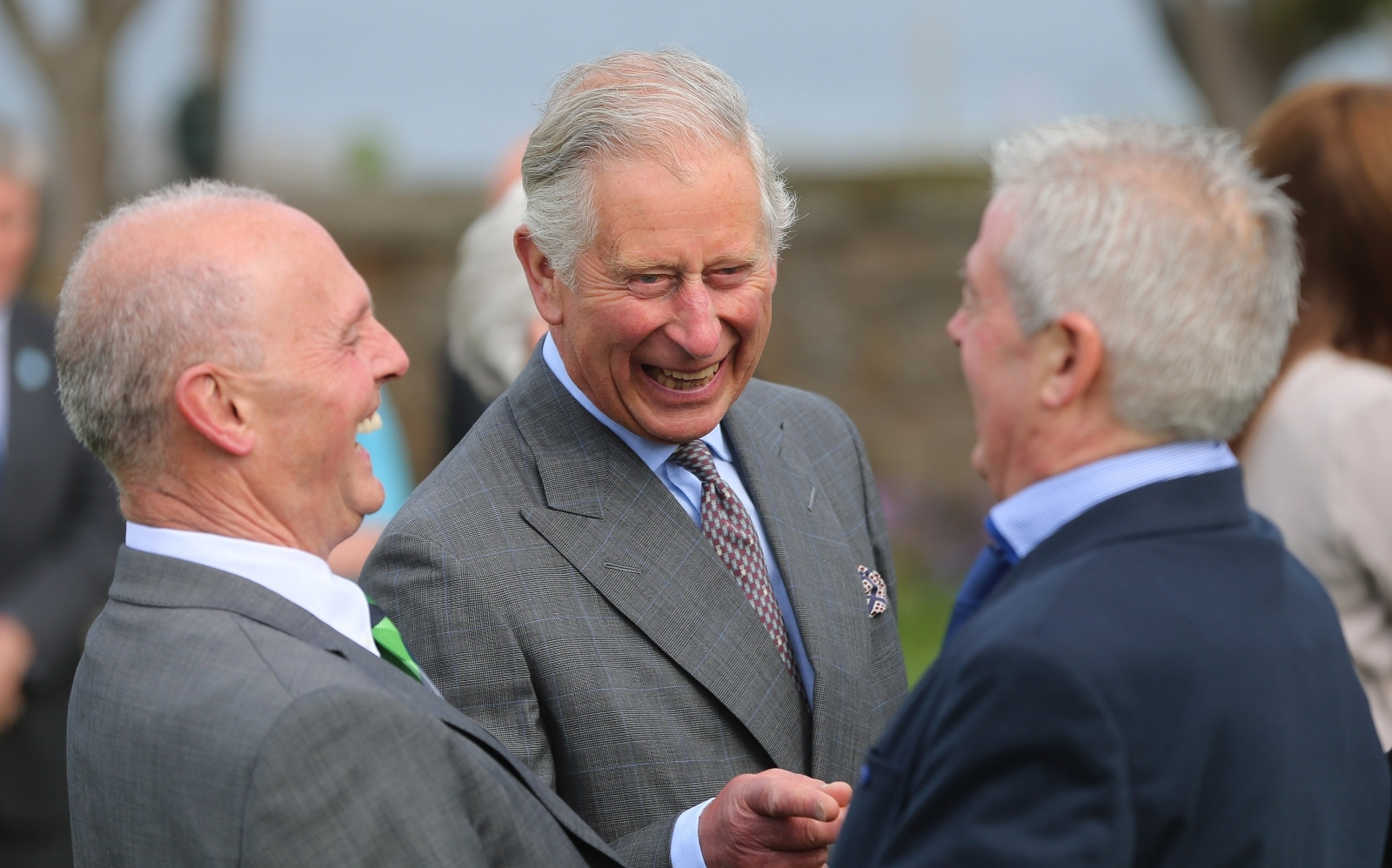 Prince Charles, Prince of Wales laughs as he is introduced to Lord Mountbatten's former staff by Peter McHugh (L) during a visit to the peace garden on May 20, 2015 in Sligo, Ireland