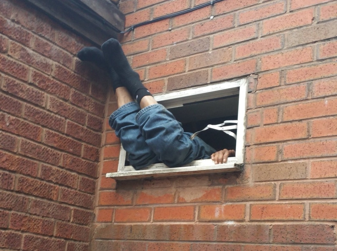Hapless burglar suspect gets stuck for SEVEN hours in takeaway window