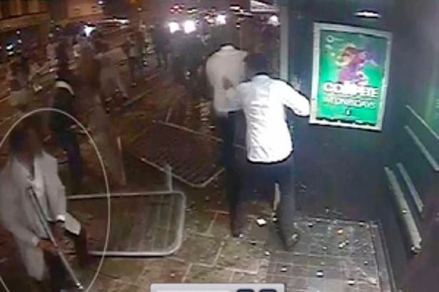Hans Sojhe, who is charged with violent disorder, is circled in a still from the video about to throw a metal pole into a section of the crowd outside a club in Bristol