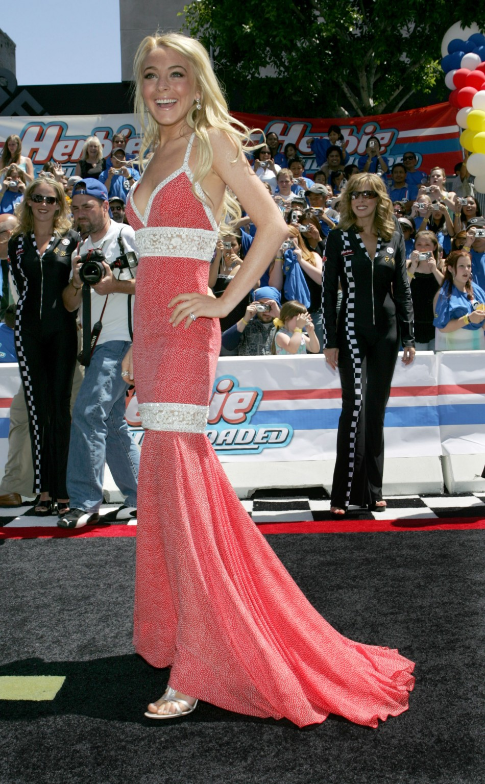 "Actress Lindsay Lohan poses for the photographers at the world premiere of Disney Pictures' ""Herbie."""