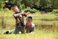 Hunter helps son with target practice