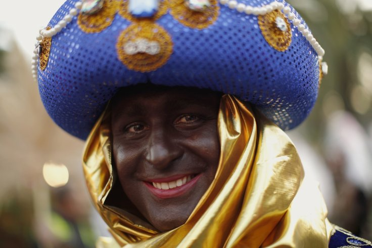 Man dressed as Balthazar with black face