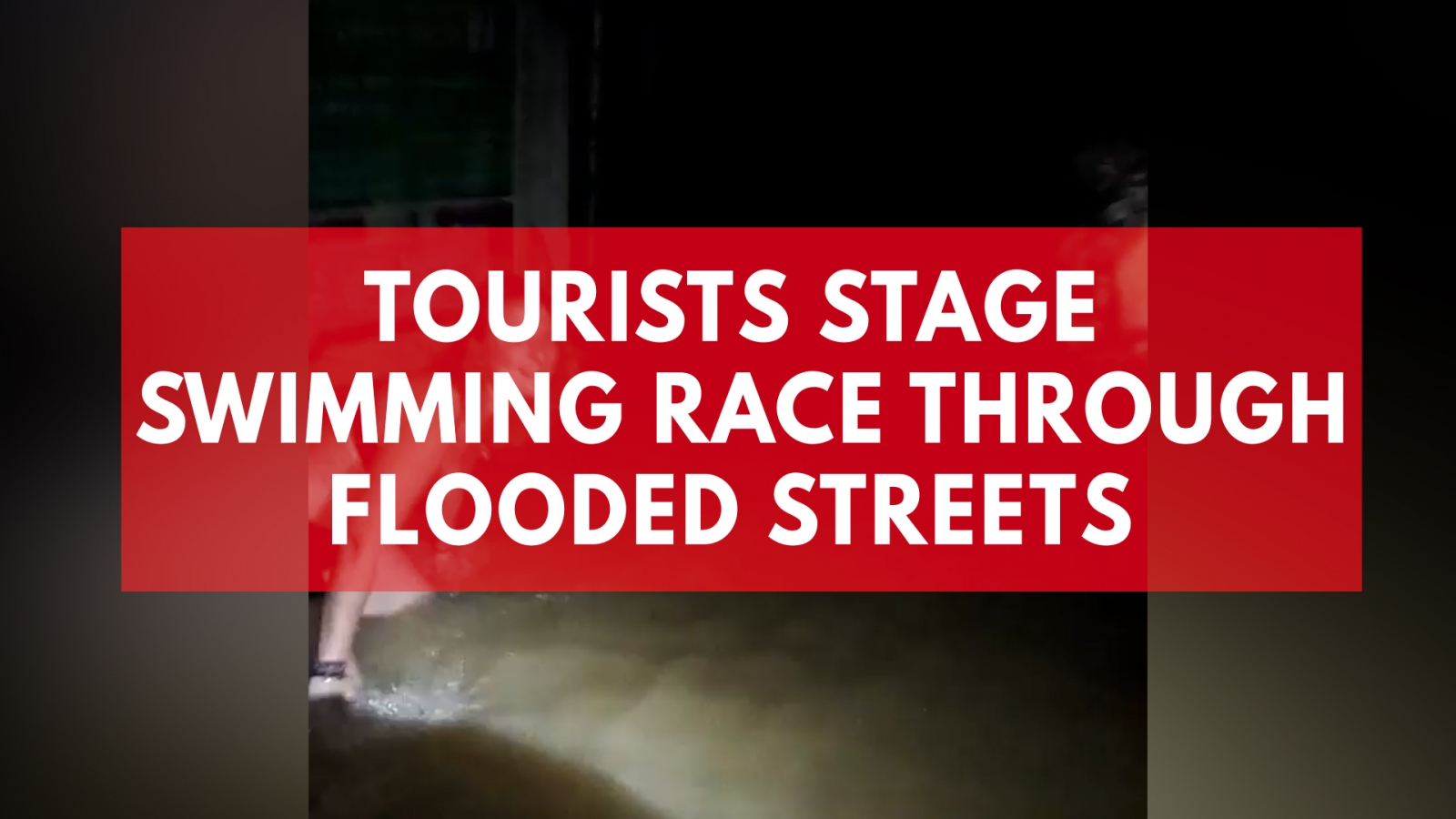 tourists-stage-swimming-race-through-flooded-street