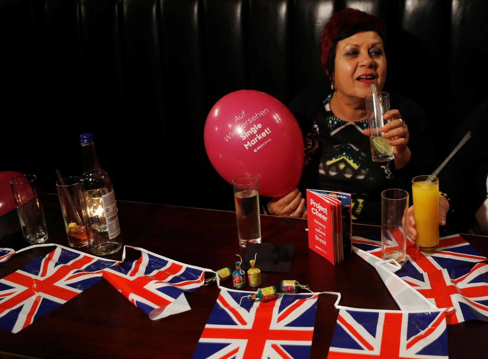 A woman holds a Pro-Brexit balloon in a pub at an event to celebrate the invoking of Article 50 after Britain's Prime Minister Theresa May triggered the process by which the United Kingdom will leave the European Union, in London, Britain March 29, 2017