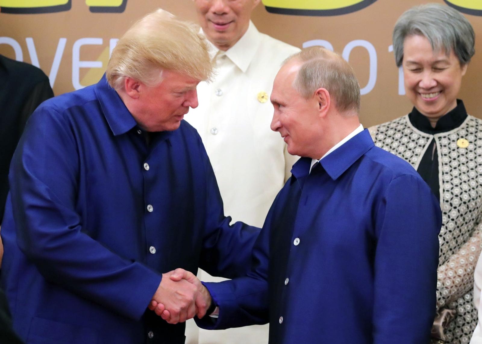 Trump and Putin shake hands in Vietnam