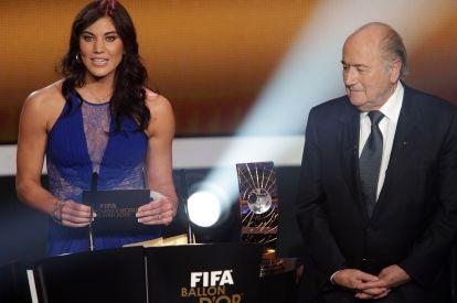 Hope Solo and Joseph Blatter