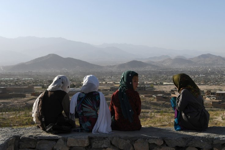 Afghan girls looking out to Kabul