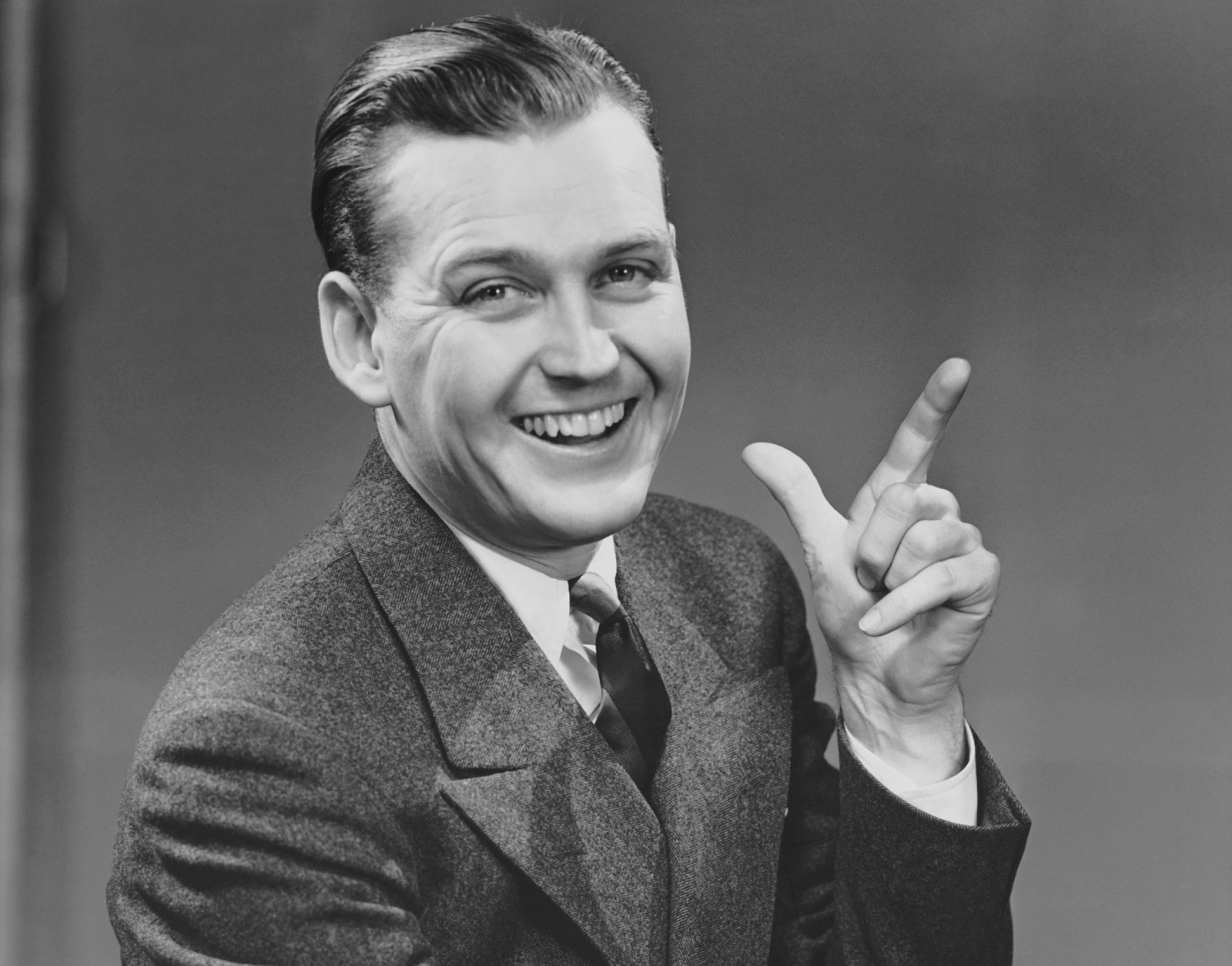 Man smiling and gesturing