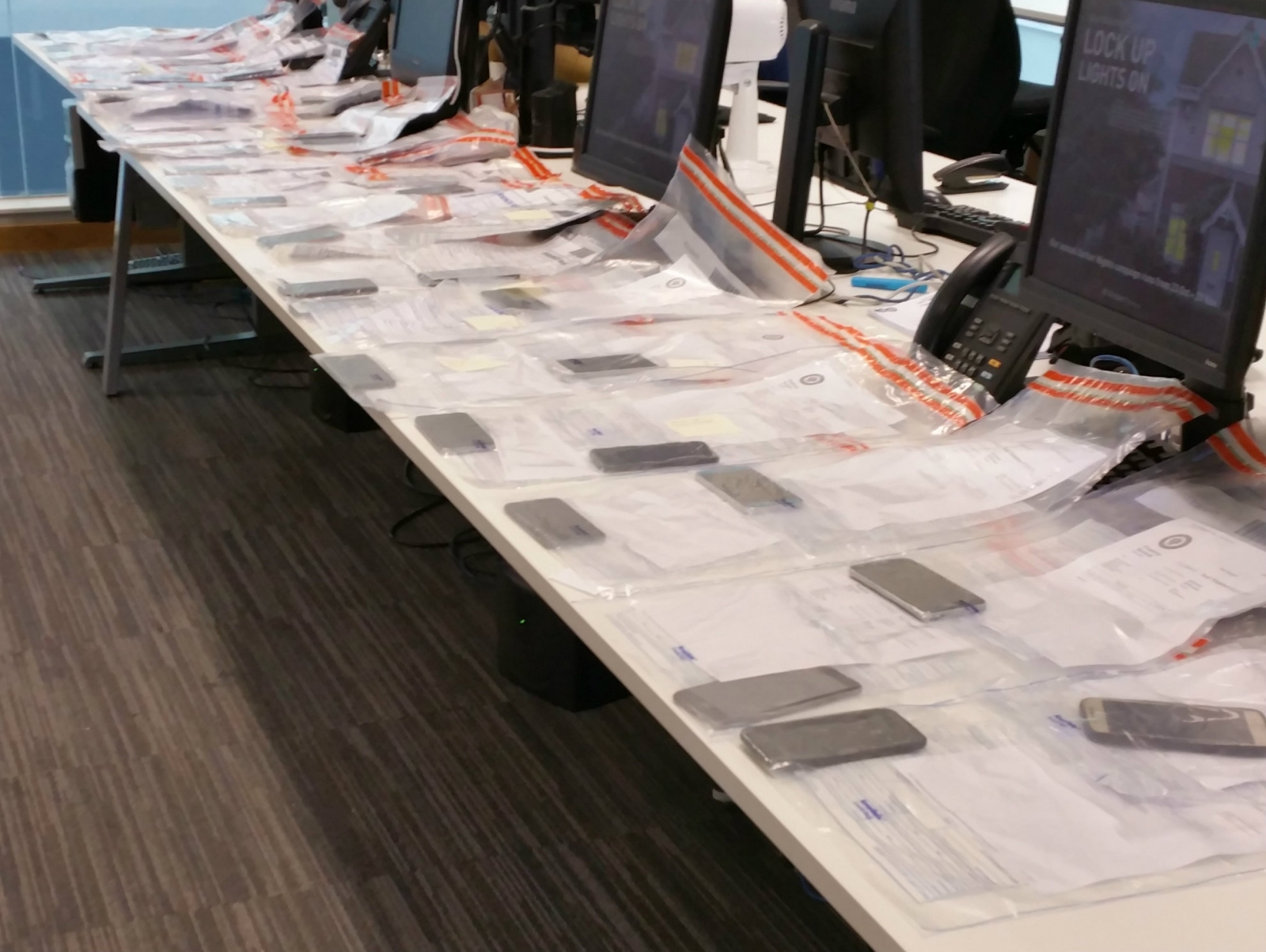 Suspect caught with 53 phones