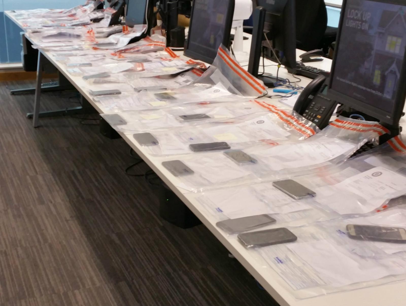 Suspect caught with 53 phones