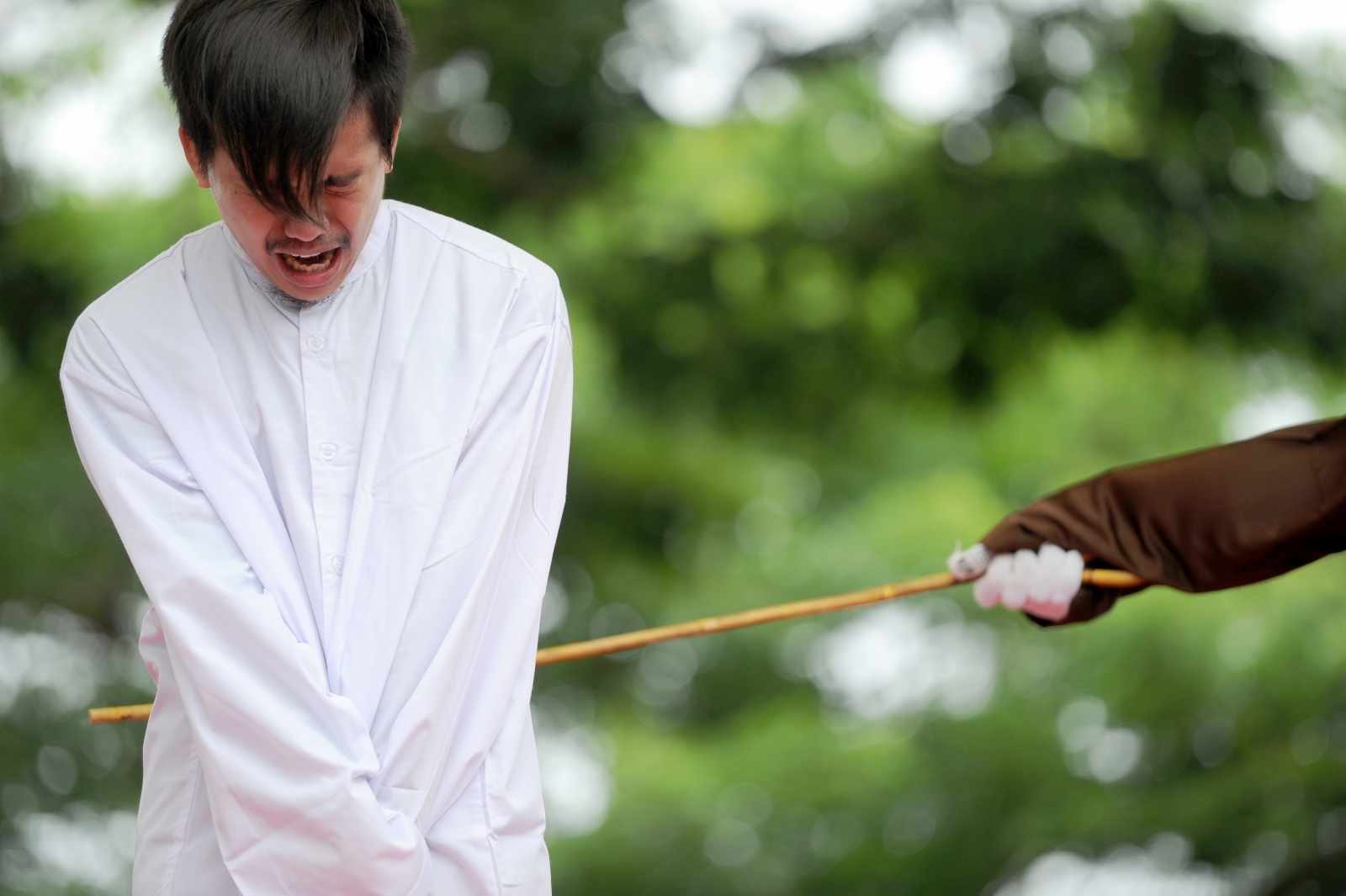 Man caned for allegedly being gay Indonesia