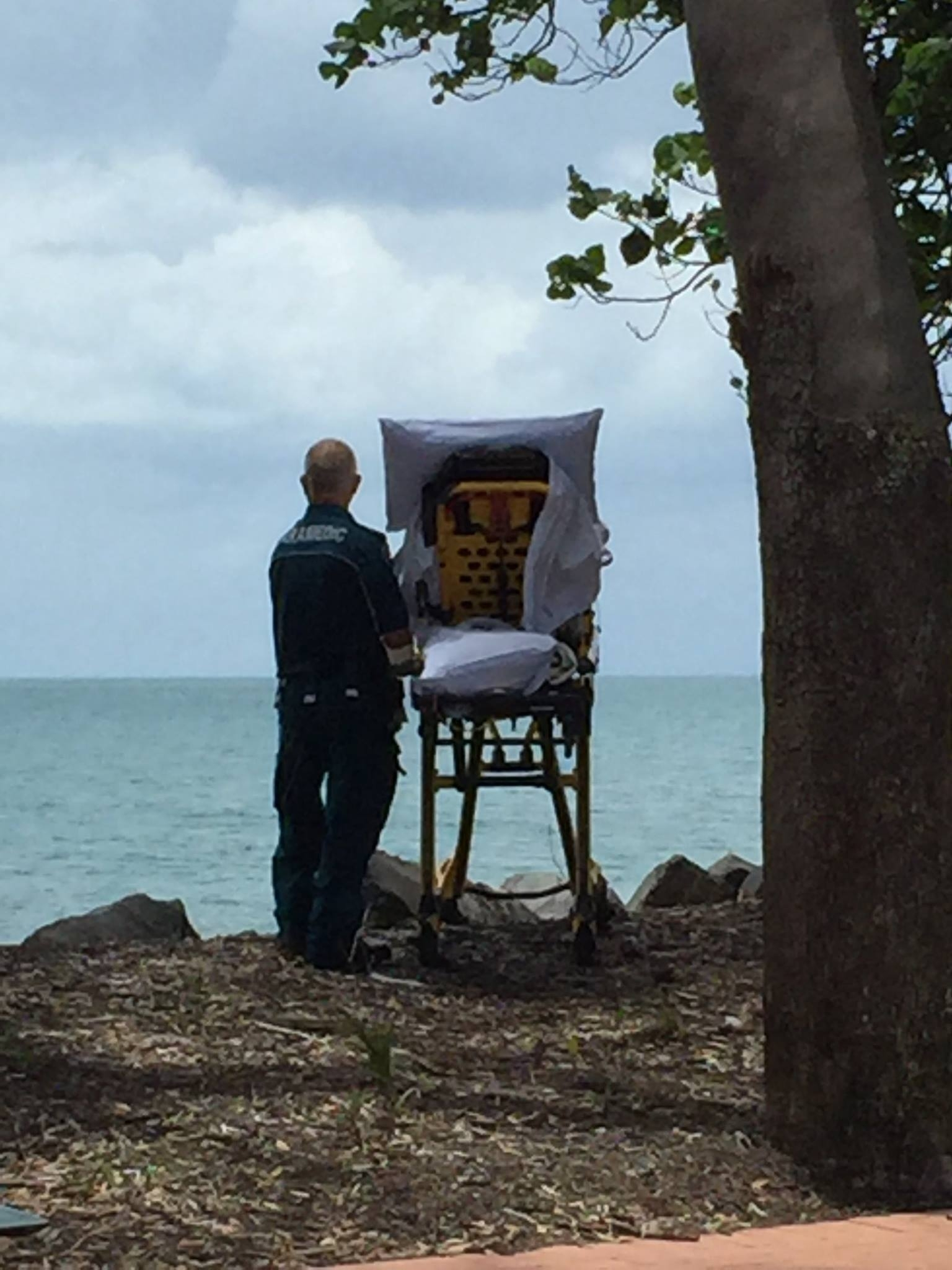Dying palliative patient on beach