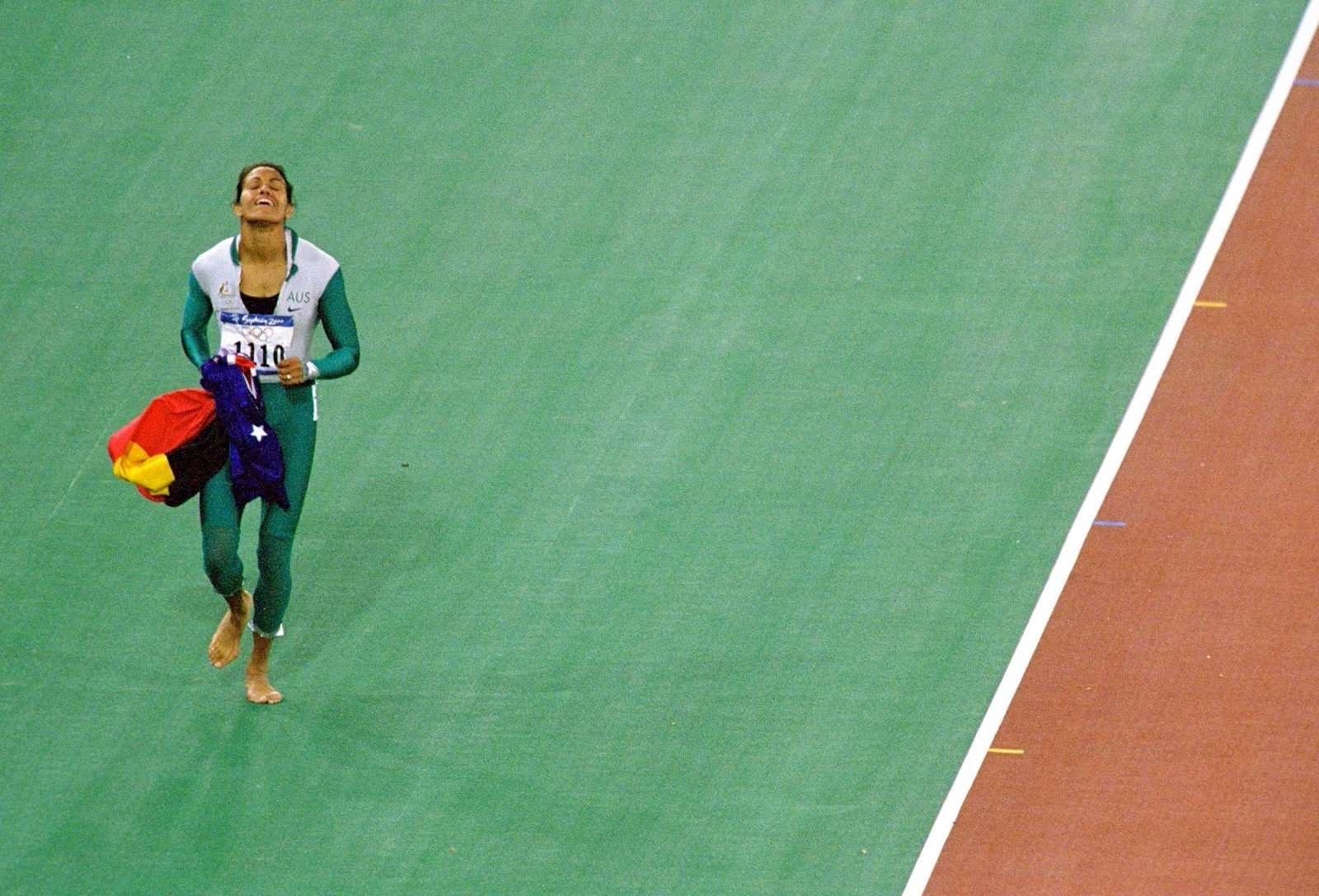 Cathy Freeman of Australia celebrates winning gold in the Womens 400m Final at Australia's Olympic Stadium during Sydney games in 2000