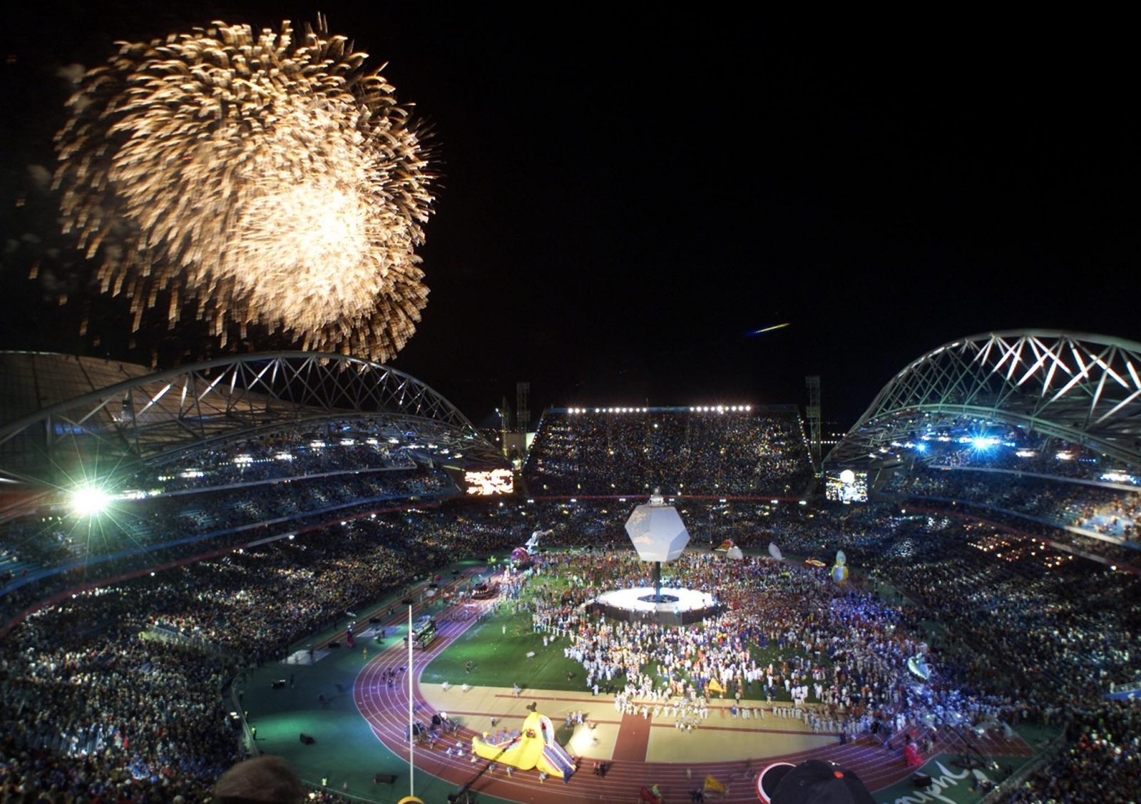 Fireworks explode over Australia's Olympic Stadium during the closing ceremonies of the games in Sydney Games in 2000
