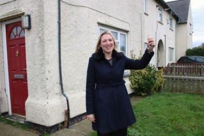 Shoreline Housing Partnership manager with keys