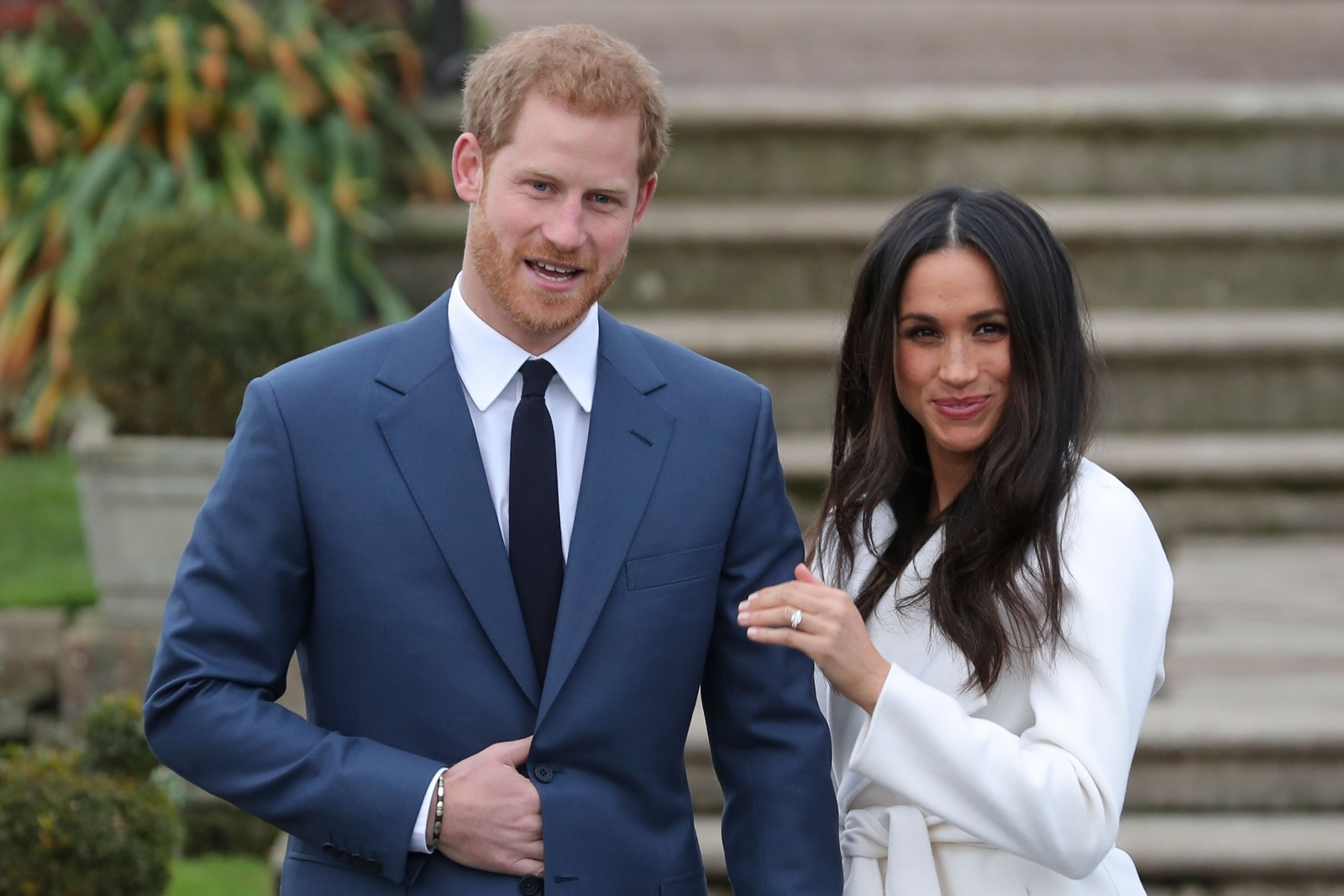 Prince Harry and Meghan Markle pose for photo after their engagement announcement, Markle flashes her glittering diamond ring