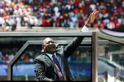 Kenya's President Uhuru Kenyatta waves upon his arrival to his inauguration ceremony where he will be sworn in as president at Kasarani Stadium in Nairobi, Kenya