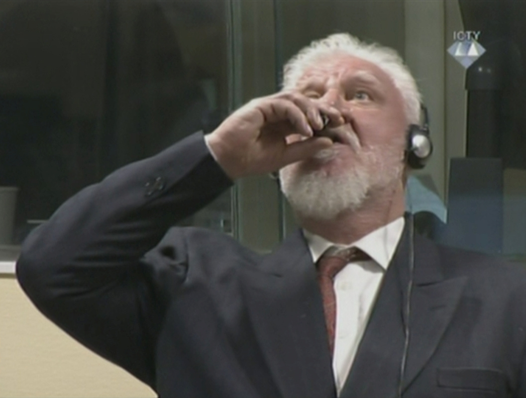 United Nations war crimes defendant claims to drink poison in court