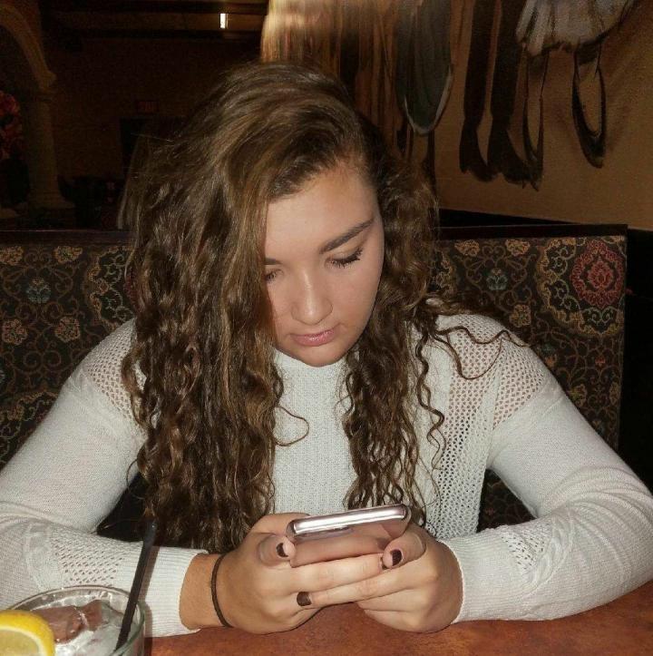 Teen using smartphone