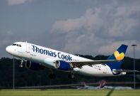 A Thomas Cook flight takes off