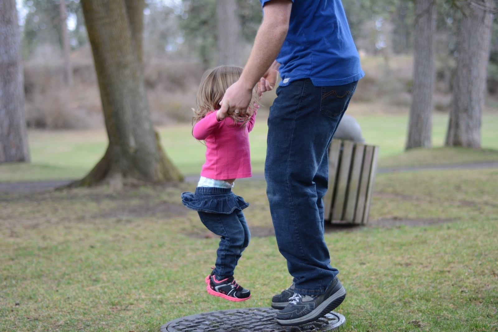 Dad and daughter jumping