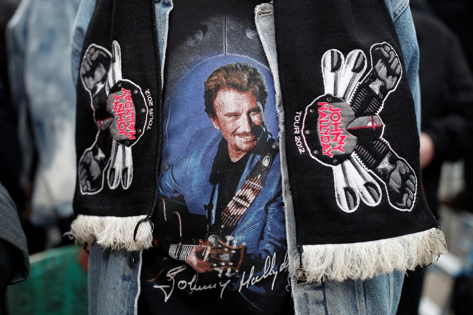 A fan of Johnny Hallyday pays his respects outside the late French singer's home in Marnes-la-Coquette near Paris, France, December 6, 2017