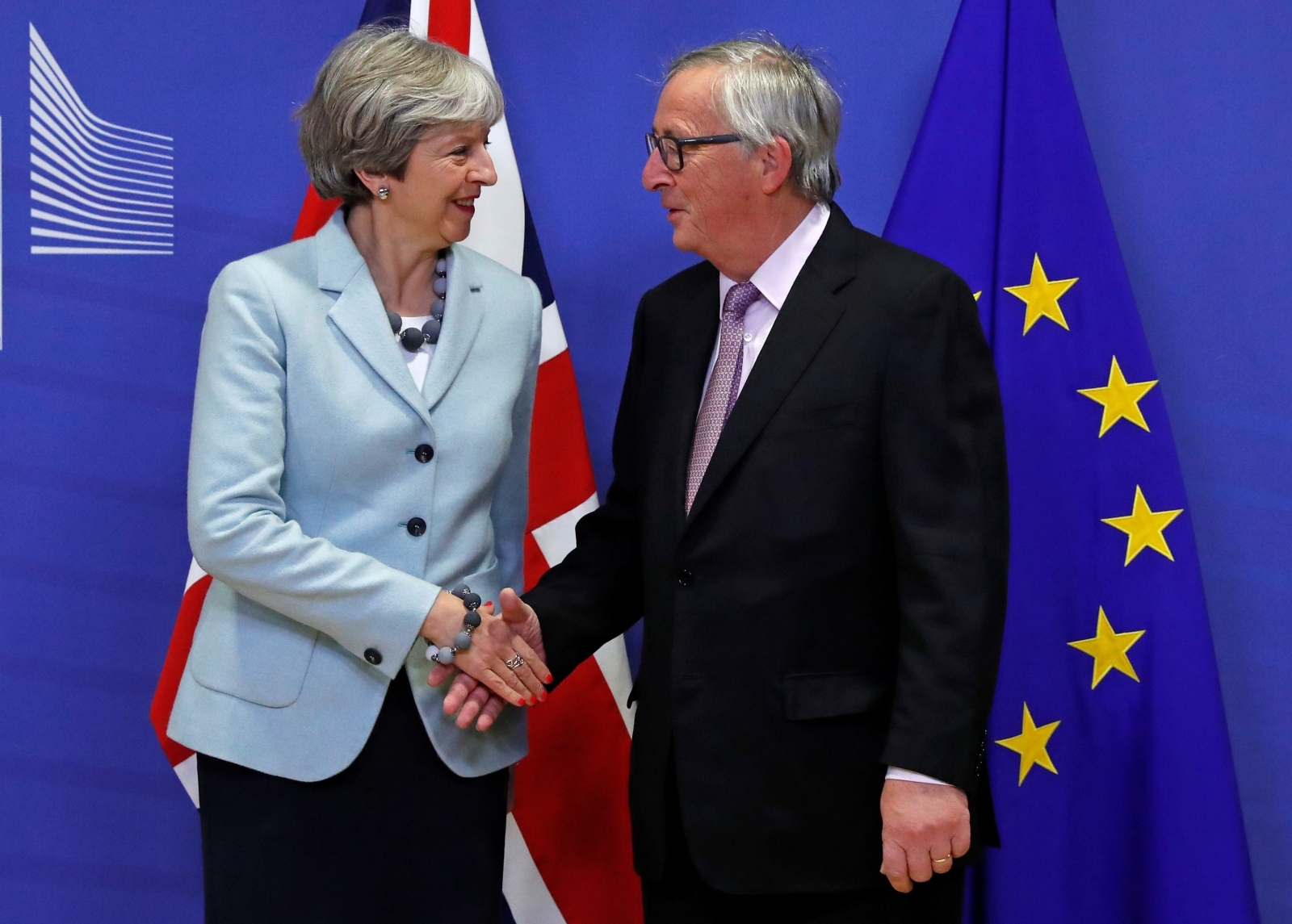 Theresa May Jean-Claude Juncker handshake