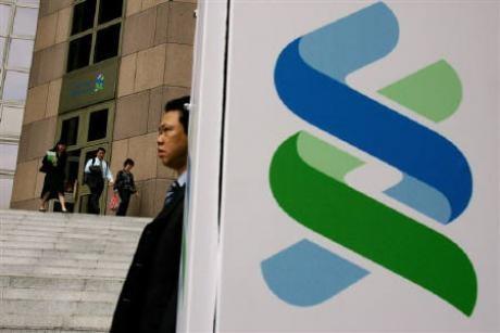 StanChart profit tops $3.1 bln as bad debts tumble