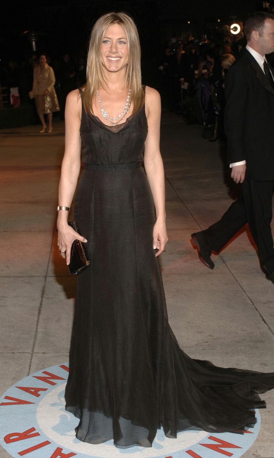 Actress Jennifer Aniston arrives at the Vanity Fair Oscar Party at Mortons