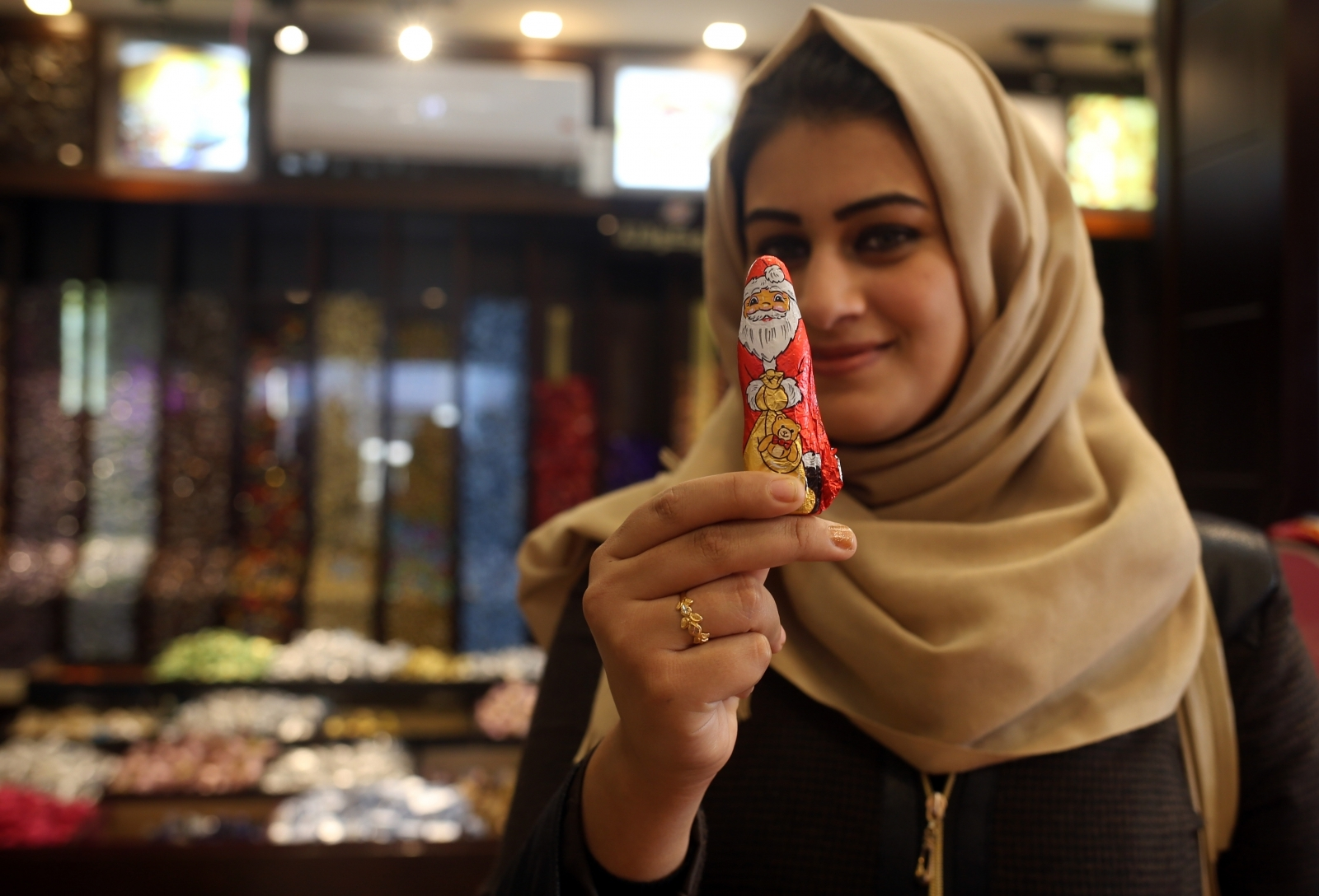 A Muslim woman with a Santa chocolate