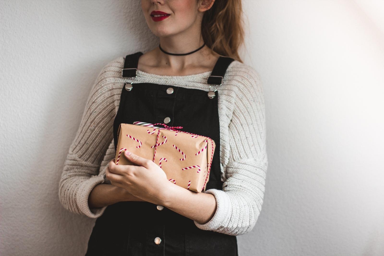 Woman holds Christmas gift