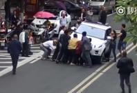 Boy under car china