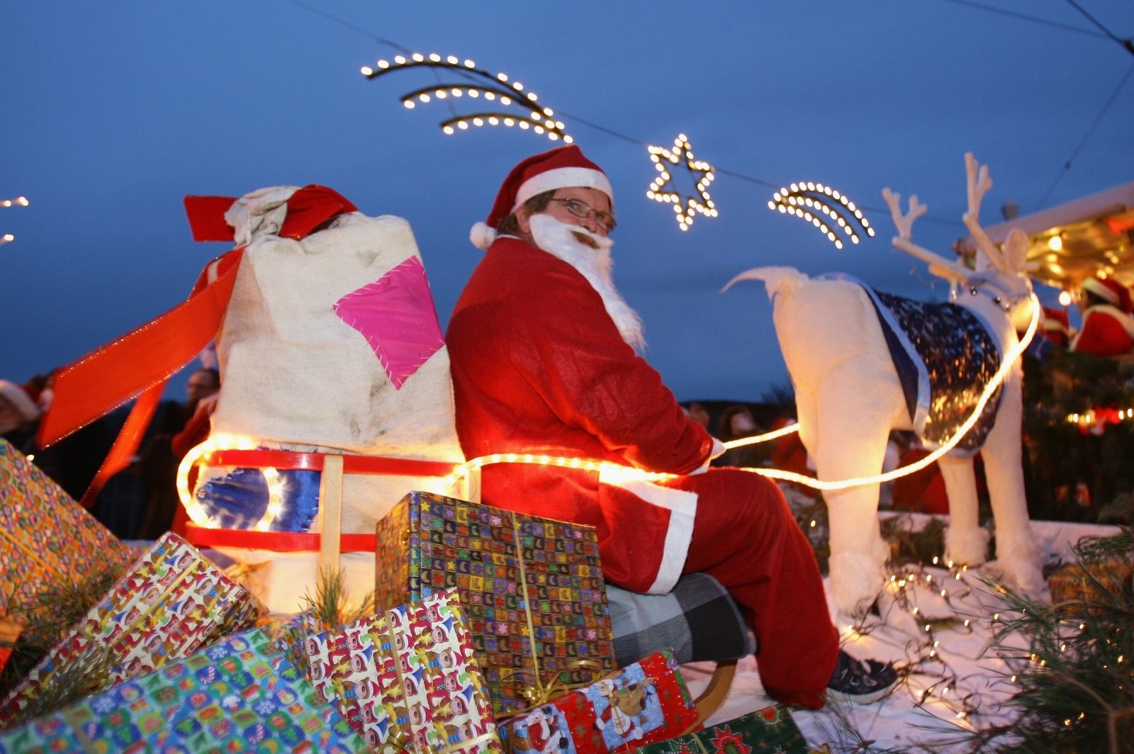 A Man Dressed In A Santa Claus Outfit Sits On A Sledge During The 11th  Santa Clauses Parade On December 5, 2009, In Brandenburg, Near Berlin,  Germany.