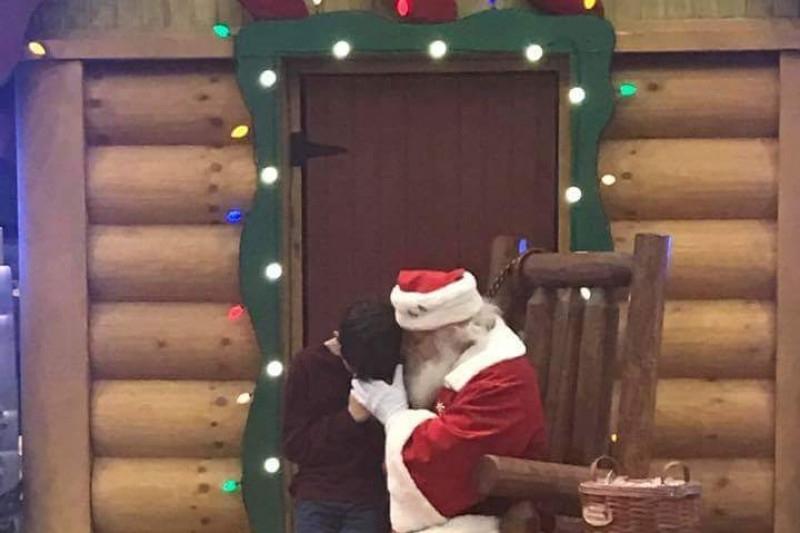 Santa praying with 12-year-old