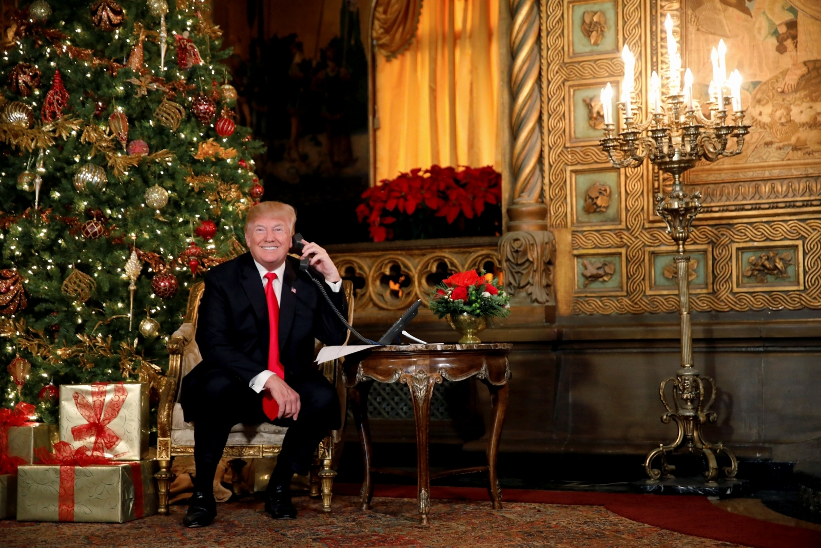 Track His Phone >> Trump and Melania participate in phone calls with children through Norad as they track Santa