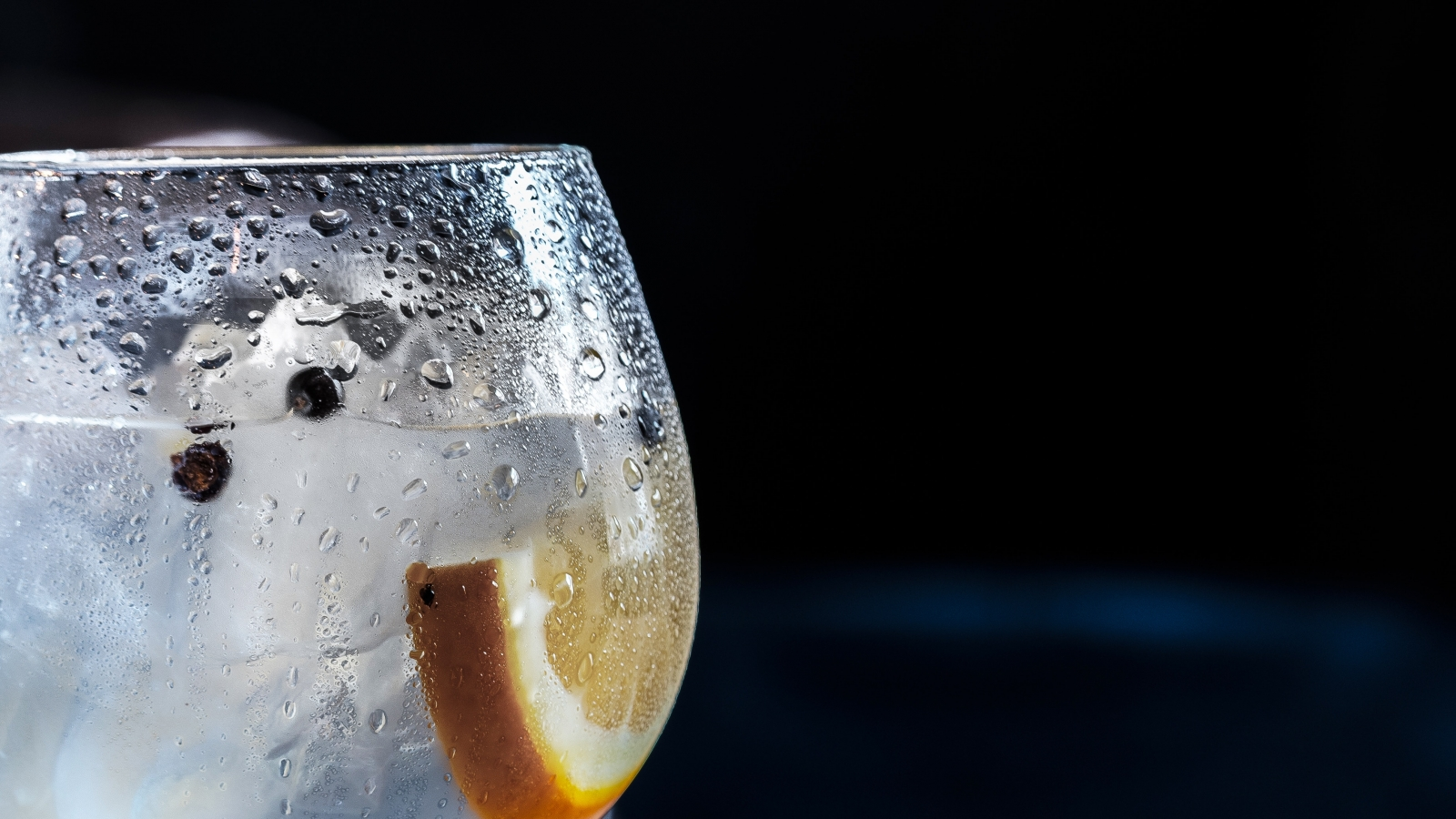 A glass of water with lemon