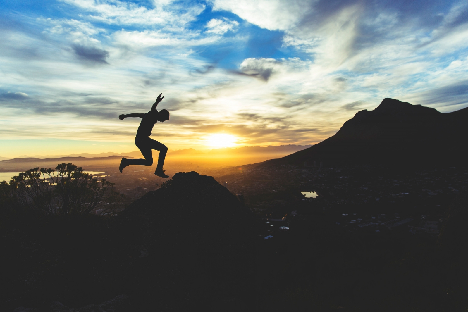 Man jumps during in front of landscape