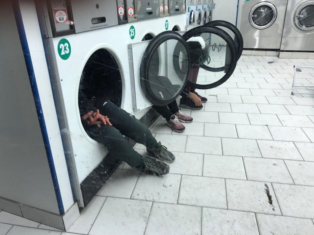 Migrants in Paris launderette