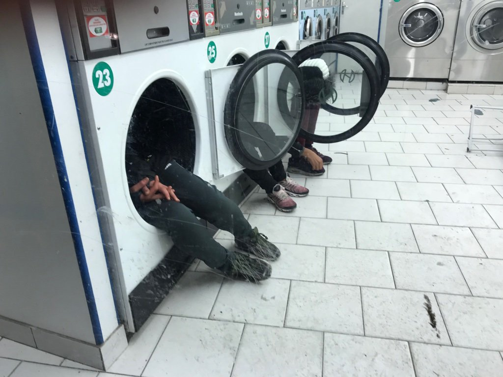 Migrants in Paris launderette