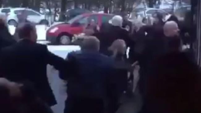 A mass brawl broke out between mourners at a Glasgow funeral