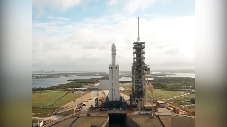 watch elon musk shares amazing time lapse video of spacex s falcon heavy rocket going vertical