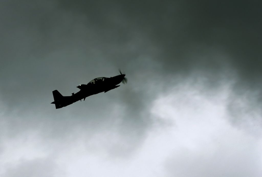 Light attack aircraft from dirt airstrip