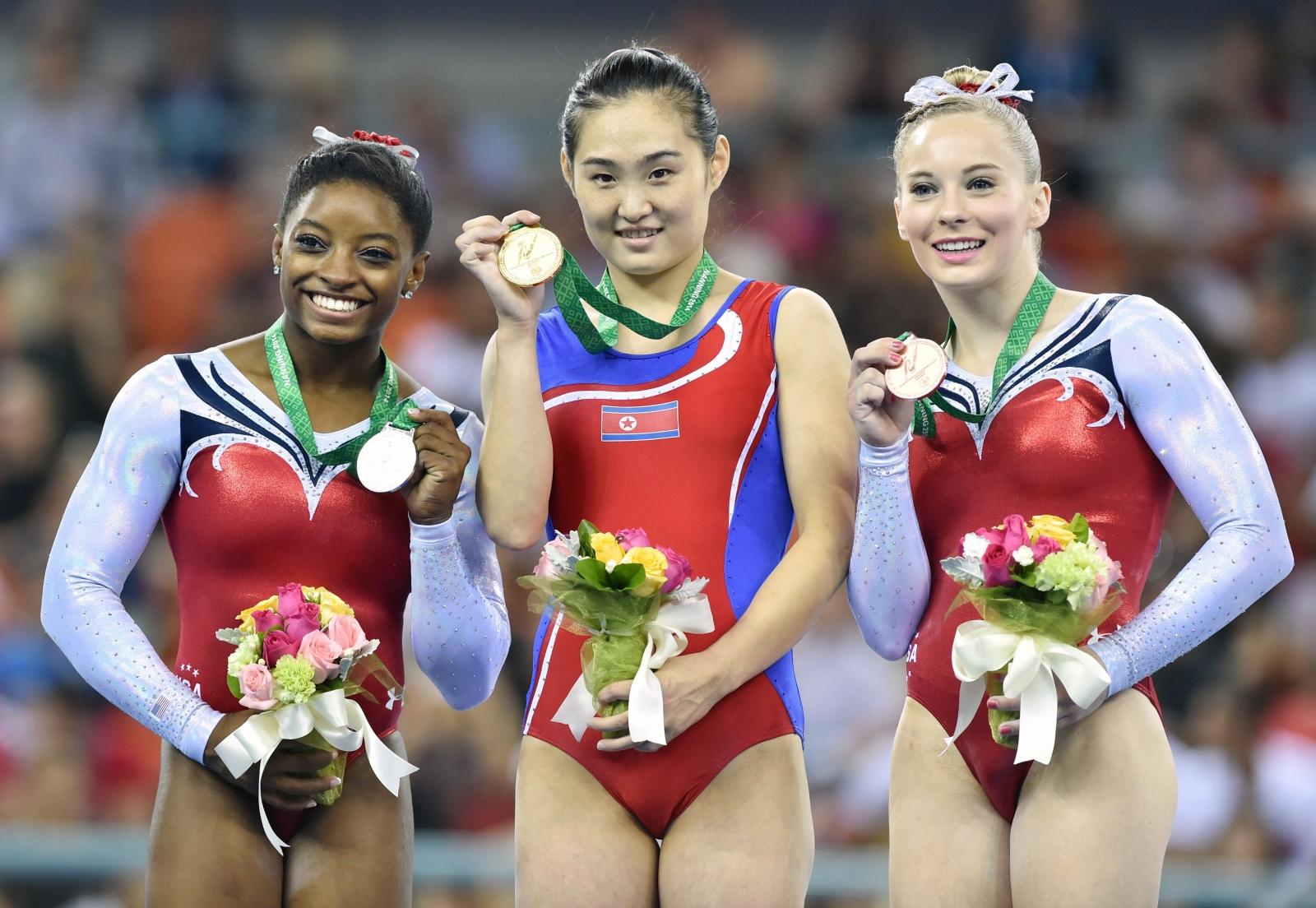 North Korean and US gymnasts posing