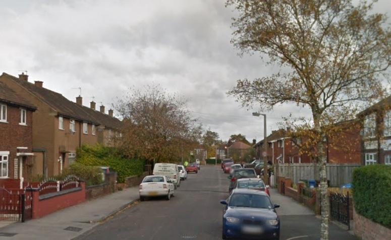 Woman held after cops dig up a body in back garden