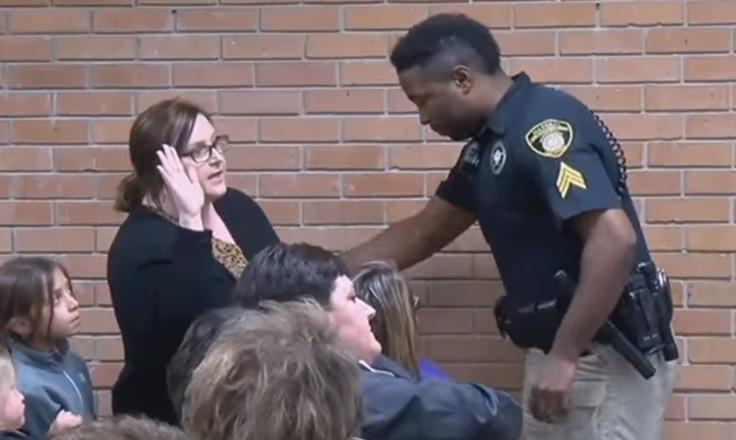Teacher put in handcuffs