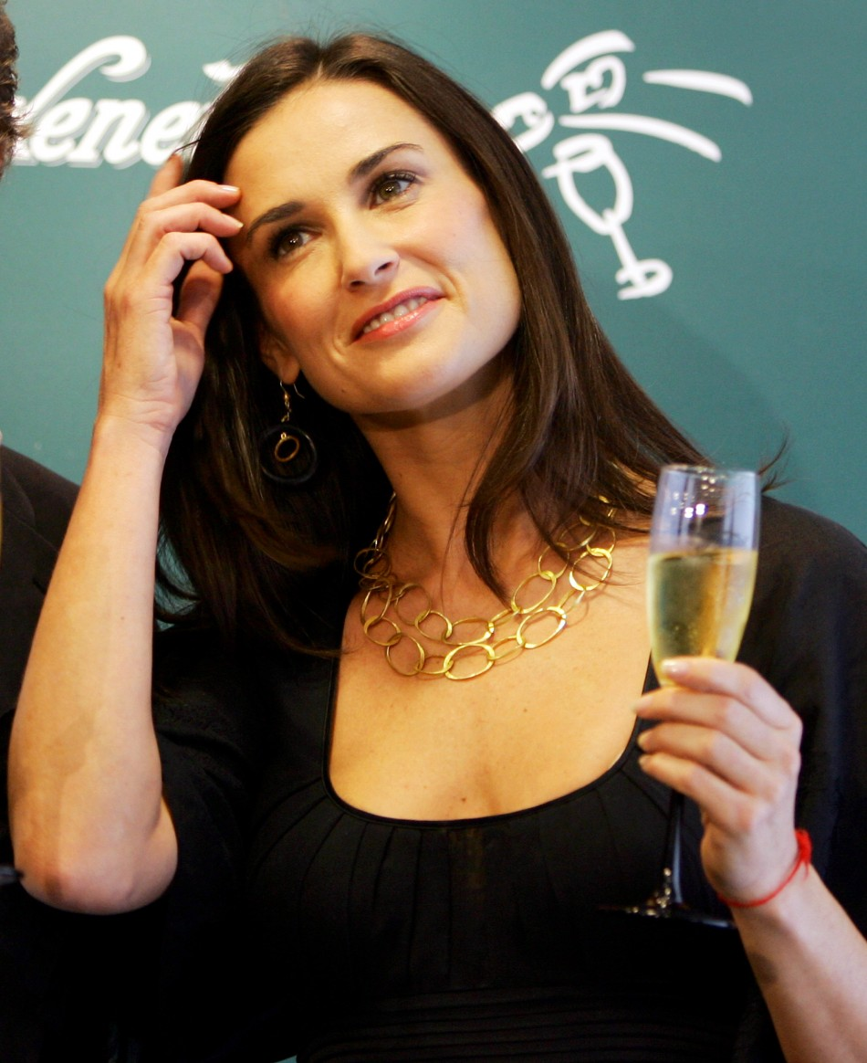 "Actress Demi Moore smiles during a photo call at the presentation of a publicity movie for a Spanish mark of ""Cava"" champagne in Barcelona"