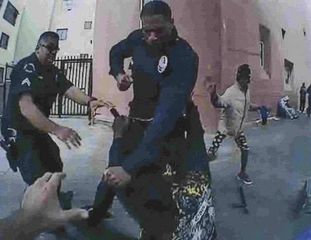 The LAPD released an enhanced image from the footage, claiming it showed the homeless man's hand on an officer's gun